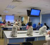 image: Pollen analysis workshop, benches, microscopes and large overhead display screens